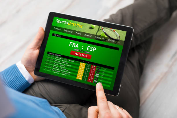 Man using sports betting app - Photo