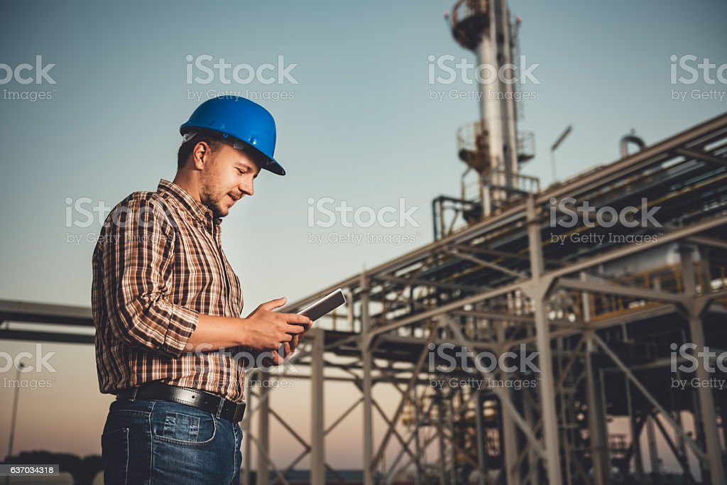 Man using tablet at factory stock photo