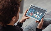 istock Man using tablet for watching VOD service 1212530706
