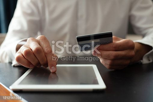 Man using Tablet pc. Credit card, Shopping online