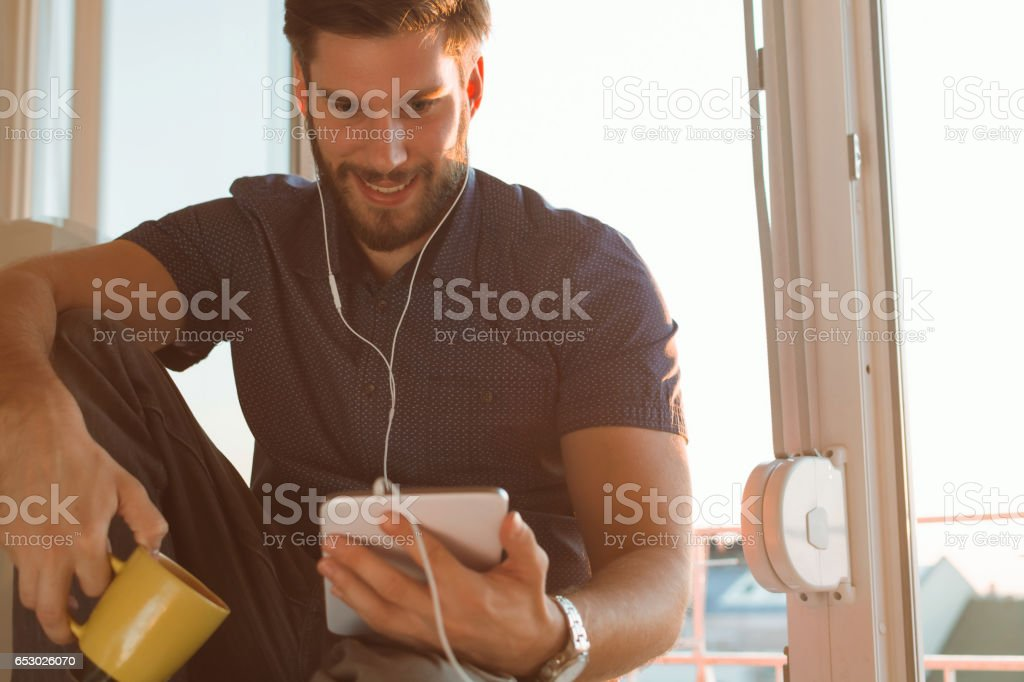 Man using tablet stock photo