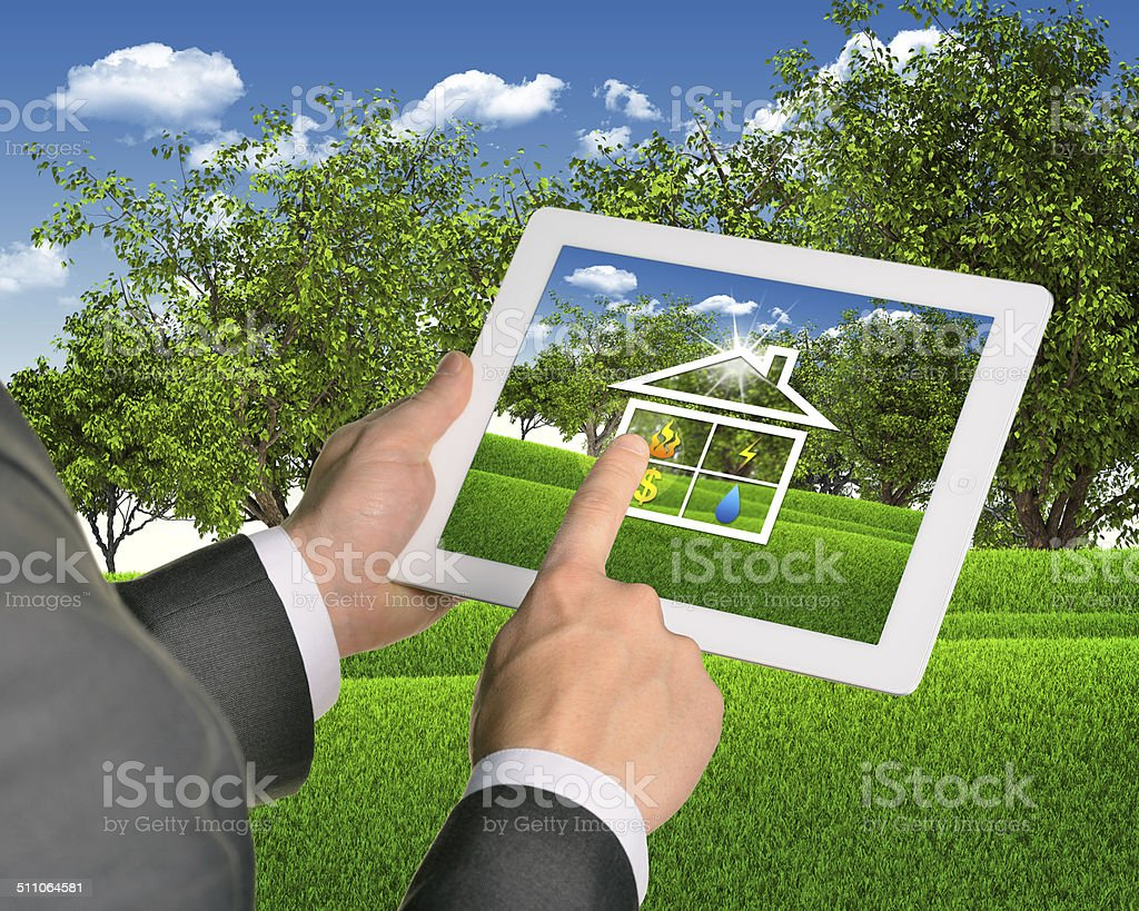 Man using tablet with symbols of public service and house stock photo