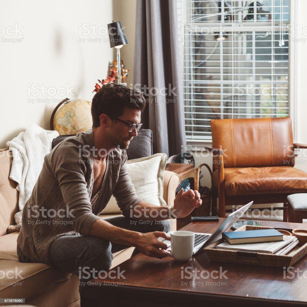 man using the laptop stock photo