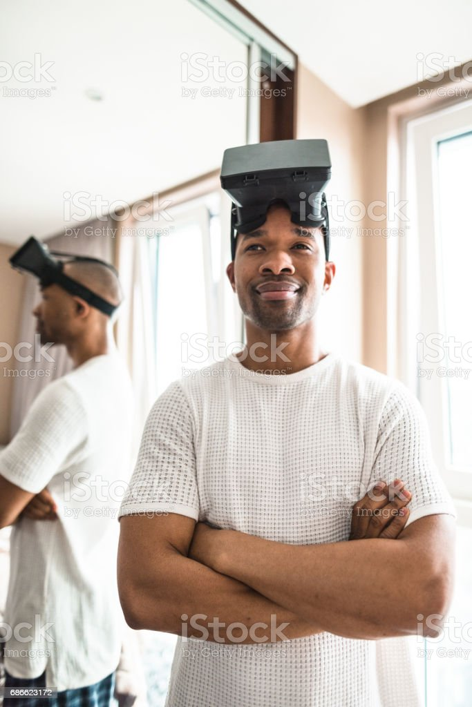 man using the virtual reality simulator at home royalty-free stock photo