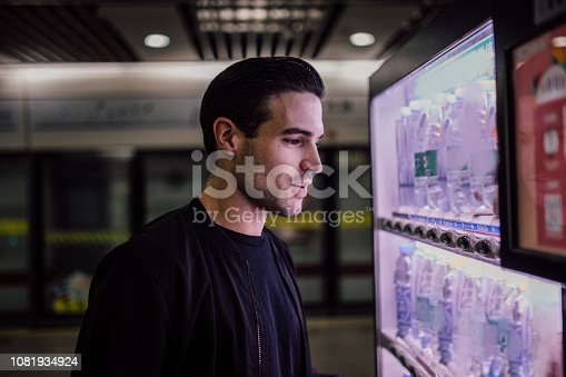 One young handsome guy using vending machine
