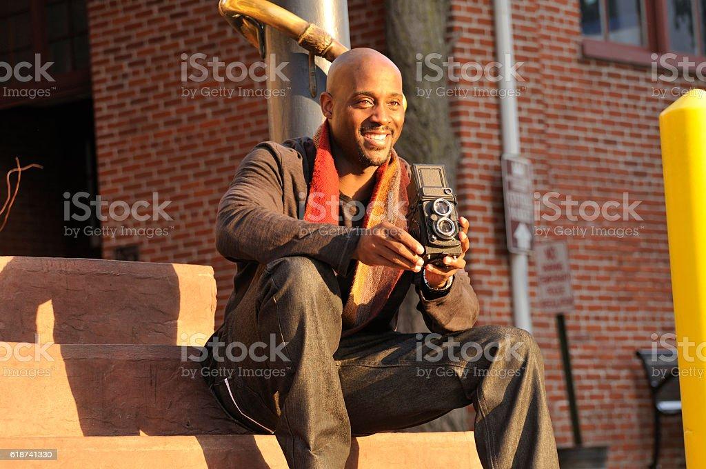 Man Using Vintage Camera stock photo