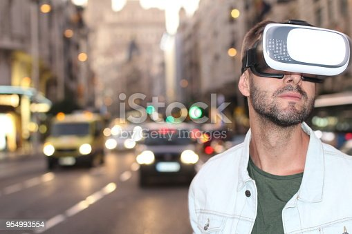 istock Man using virtual reality glasses 954993554