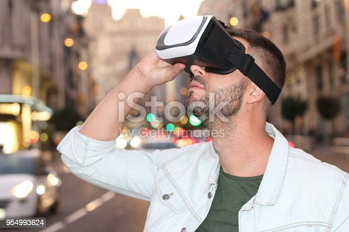 istock Man using virtual reality glasses 954993624