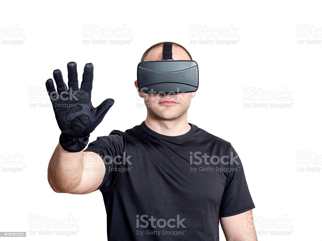 Man using virtual reality headset and touching a virtual interface stock photo