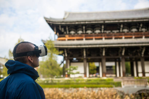 Man using virtual reality headset at a Japanese temple stock photo
