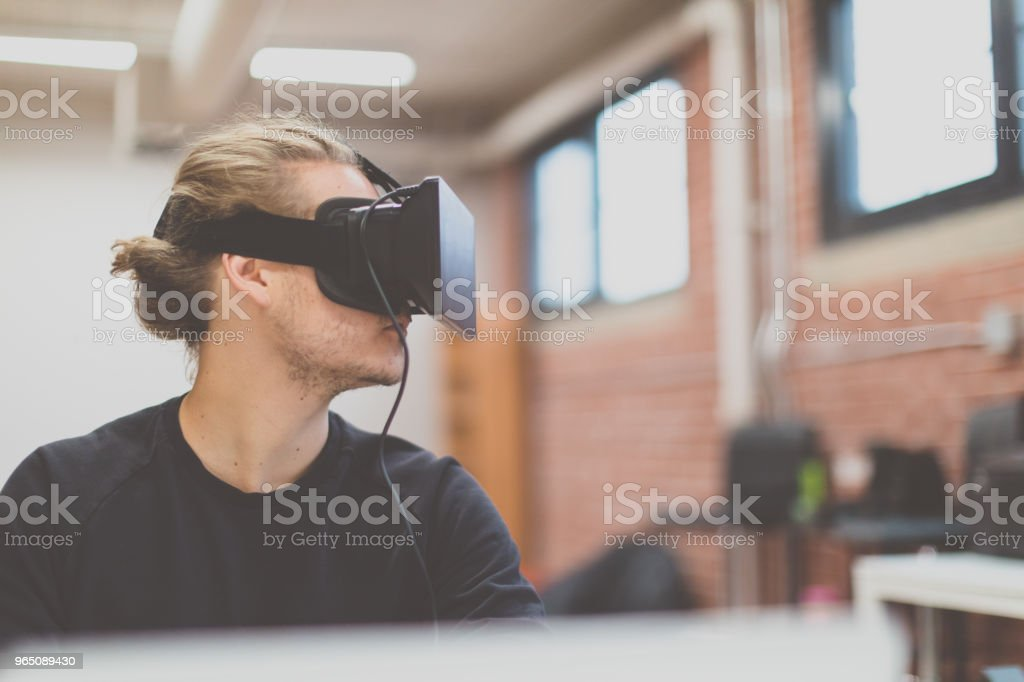 Man using virtual reality headset in a woking place royalty-free stock photo