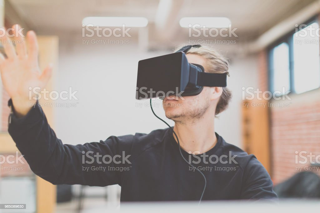 Man using virtual reality headset in a working environment royalty-free stock photo
