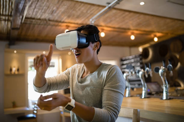 Man using virtual reality headset in restaurant stock photo