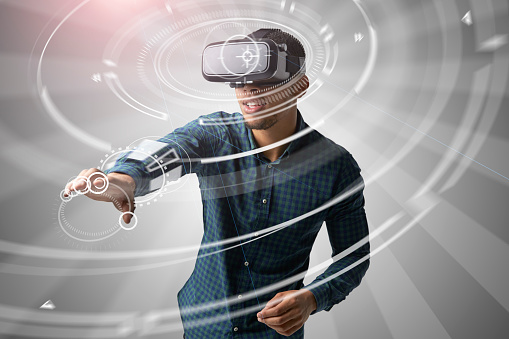 istock Man Using Virtual Reality Headset 621592090