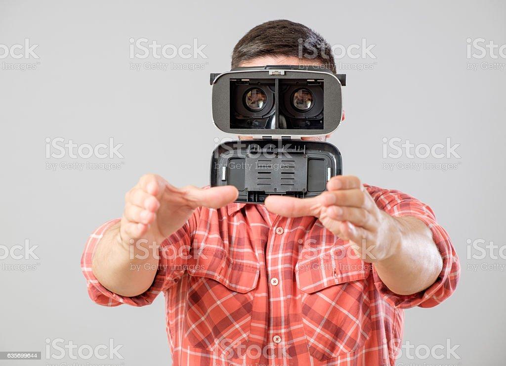 Man using virtual reality headset royalty-free stock photo