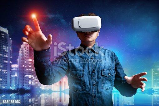 istock Man using virtual reality headset 638488150