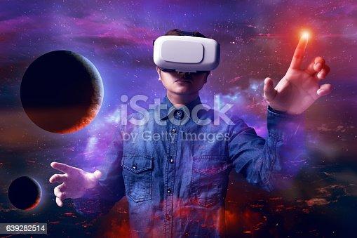 istock Man using virtual reality headset 639282514
