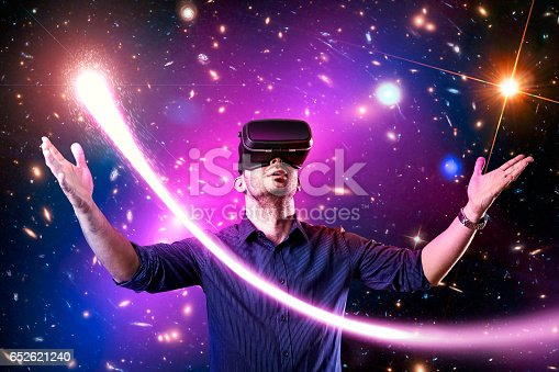 istock Man using virtual reality headset with 652621240