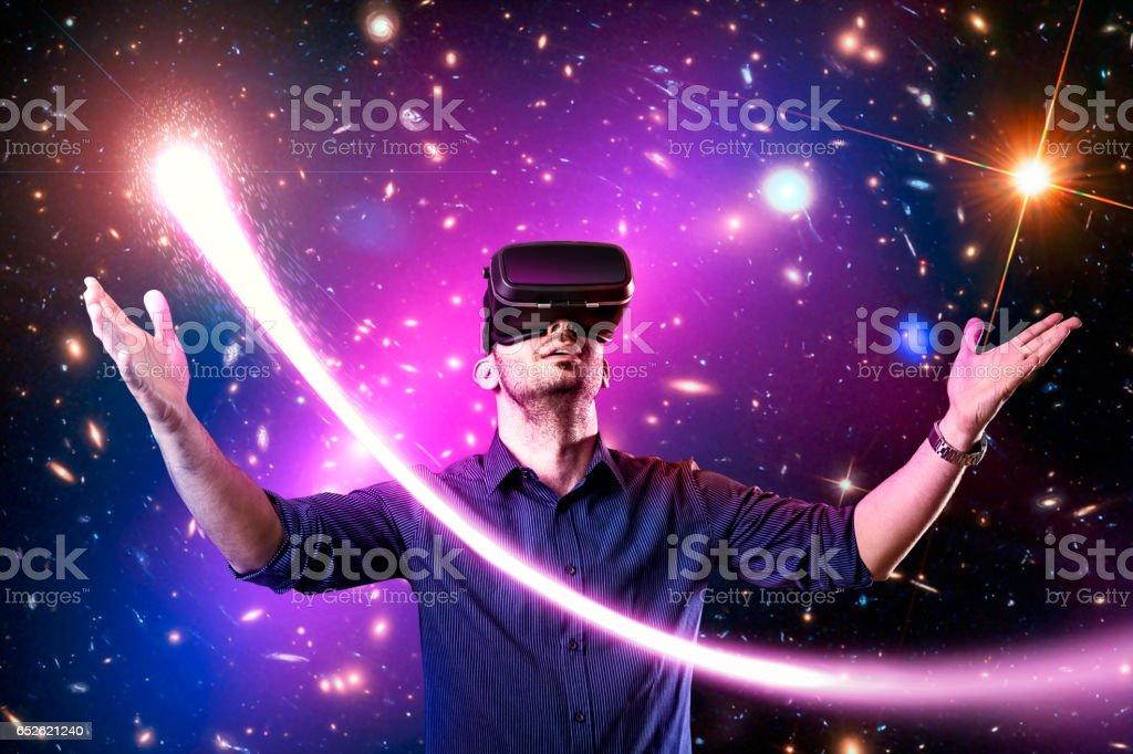 Man using virtual reality headset with stock photo