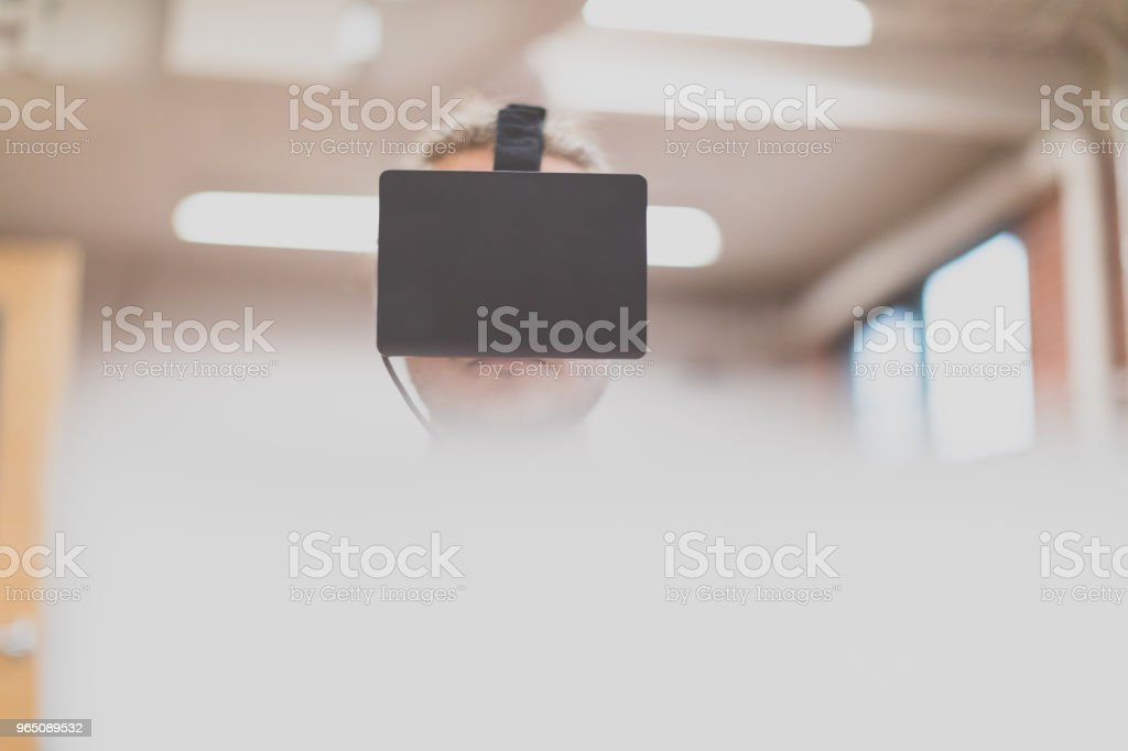 Man using virtual reality in a business office royalty-free stock photo