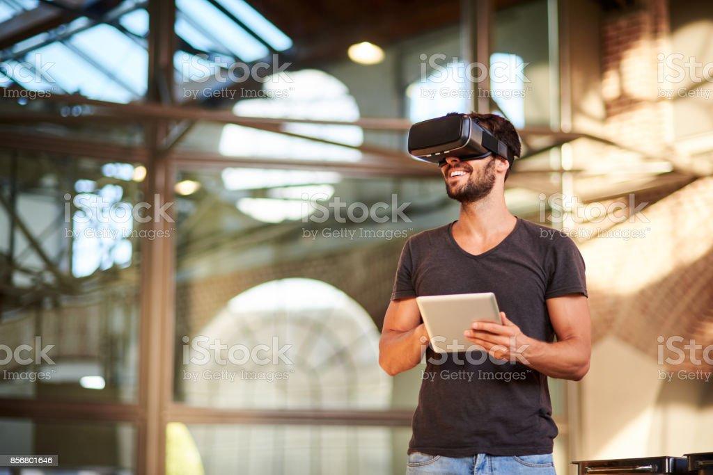 Man using virtual reality simulator headset stock photo