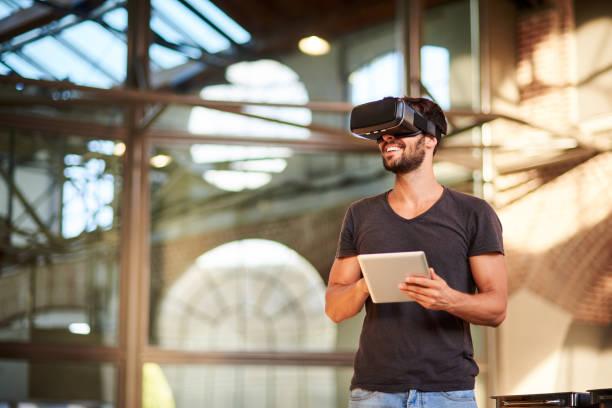 man using virtual reality simulator headset - virtual reality simulator stock pictures, royalty-free photos & images