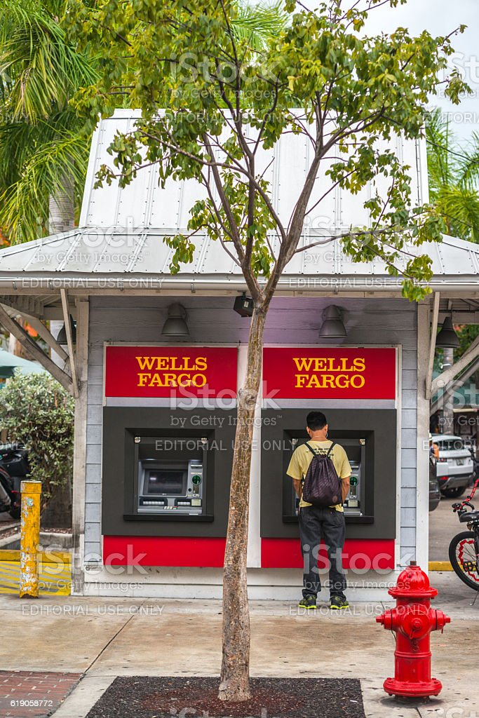 Man using Wells Fargo ATM on Duval street, Key West stock photo