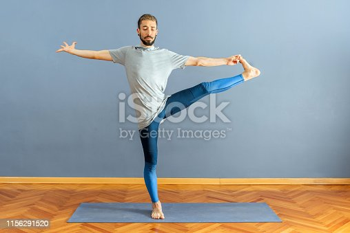 Man Utthita Hasta Padangustasana pose in yoga