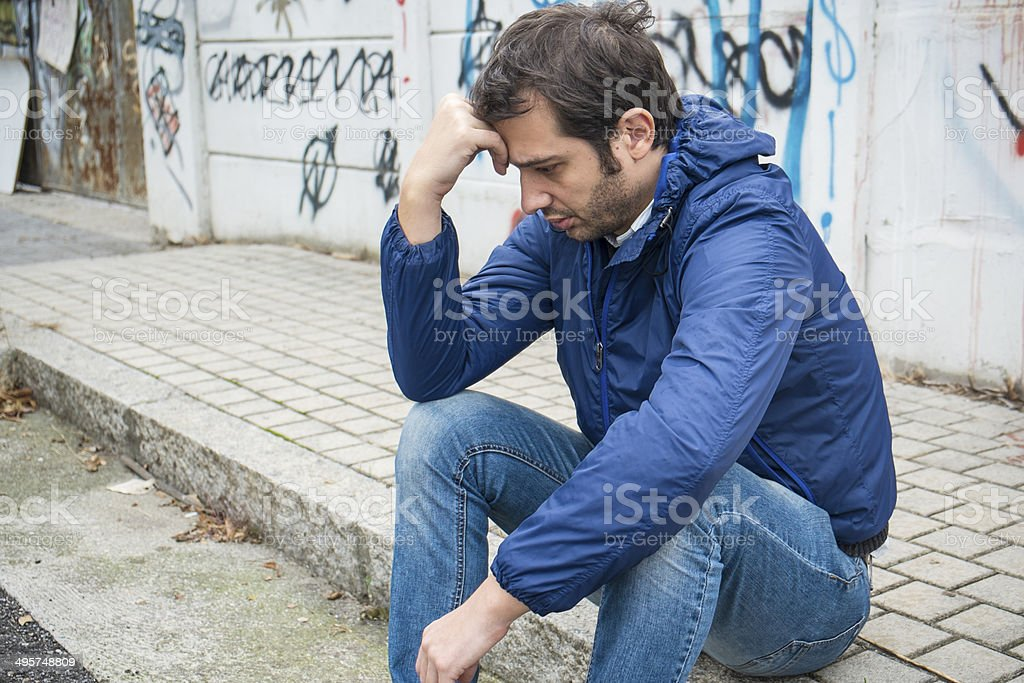 Man very depressed stock photo