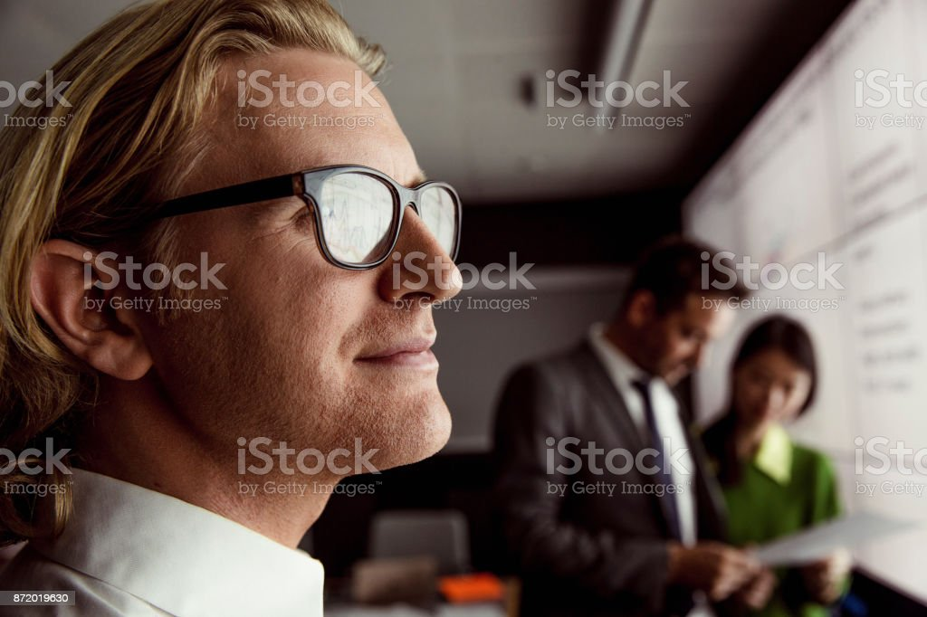 Man Viewing Data on a Large Display Screen stock photo
