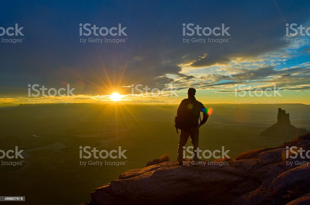 Man views sunset at the Colorado river of the Grand Canyon stock photo
