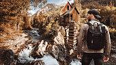 man visiting a wild cabin in Colorado