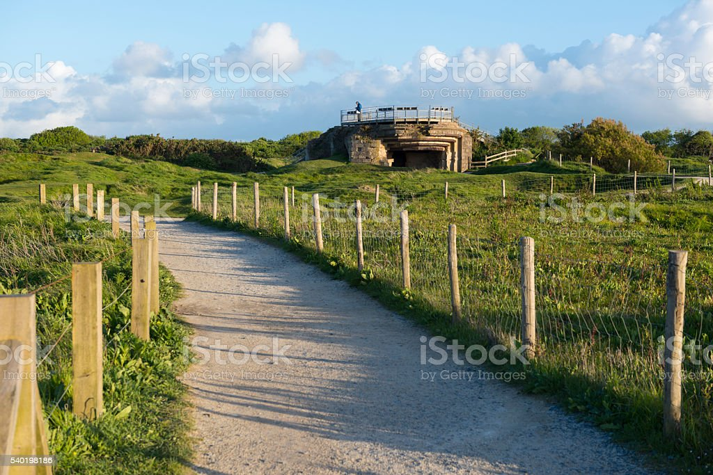Man visiting German bunker at Pointe du Hoc, Normandy, France stock photo