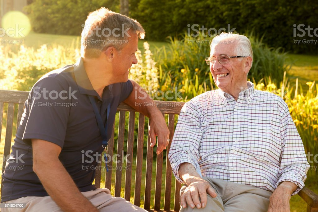 Man Visiting Senior Male Relative In Assisted Living Facility stock photo