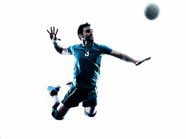 Salto de silueta hombre voleibol - foto de stock