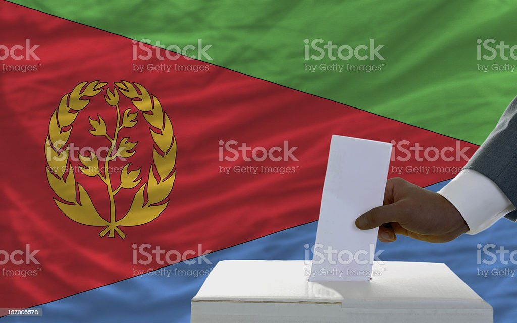 man voting on elections in front national flag of eritrea royalty-free stock photo