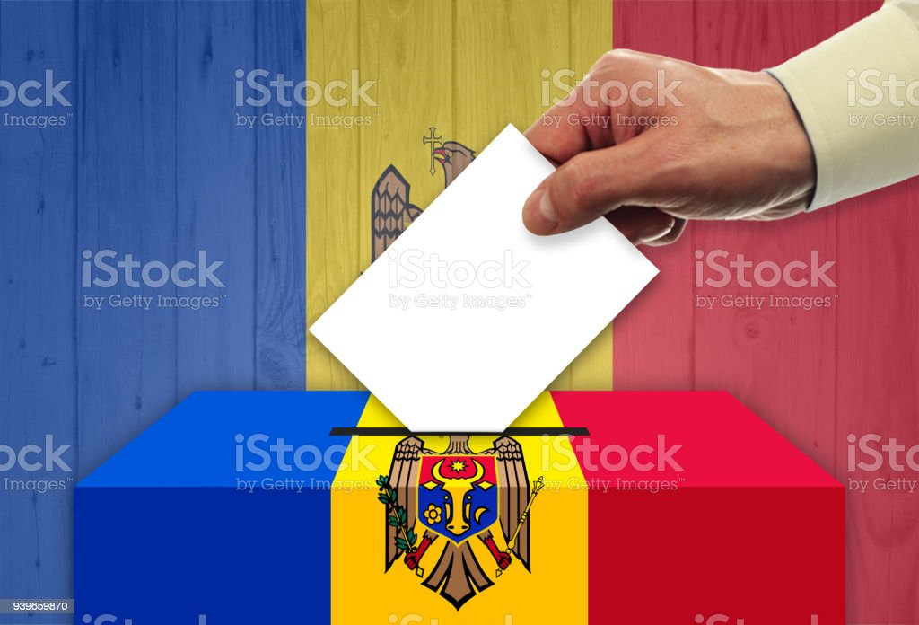 Man voting on elections in Moldova stock photo