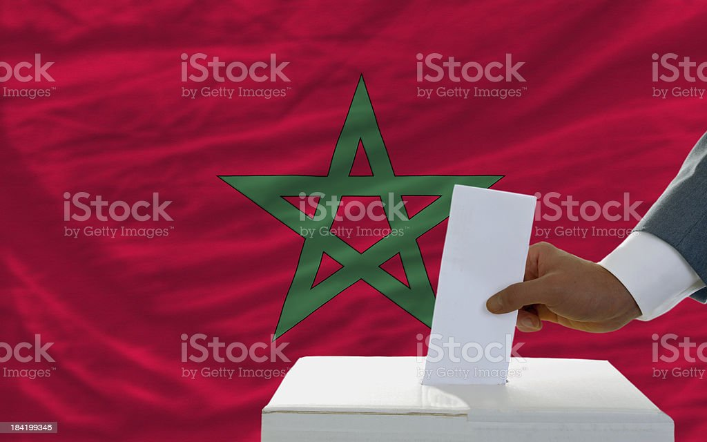 man voting on elections in morocco front of flag royalty-free stock photo