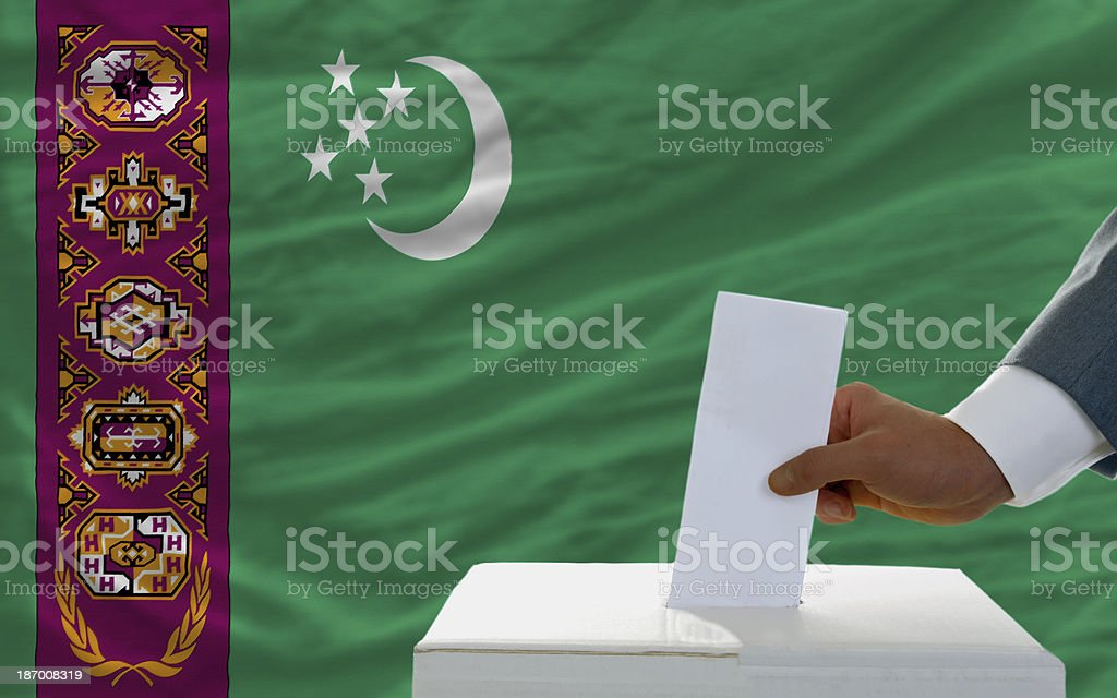man voting on elections in turkmenistan front of flag royalty-free stock photo
