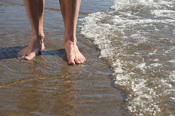 man wading in the surf - 水につかる ストックフォトと画像