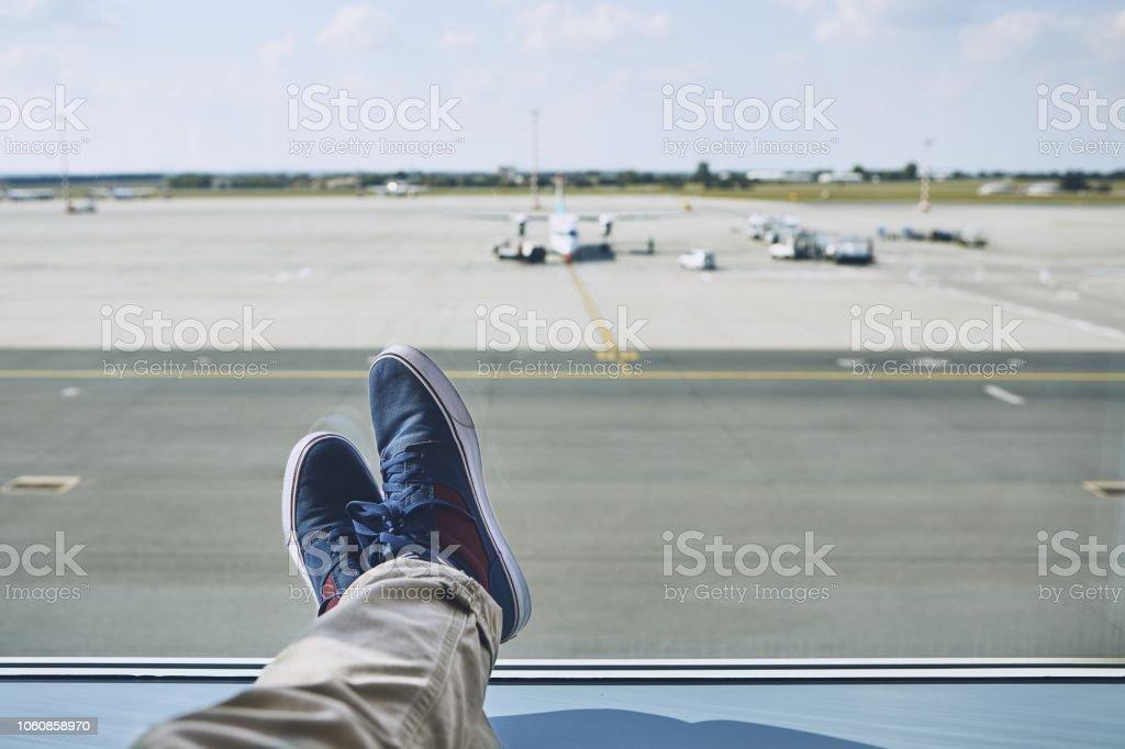 Man waiting at airport stock photo