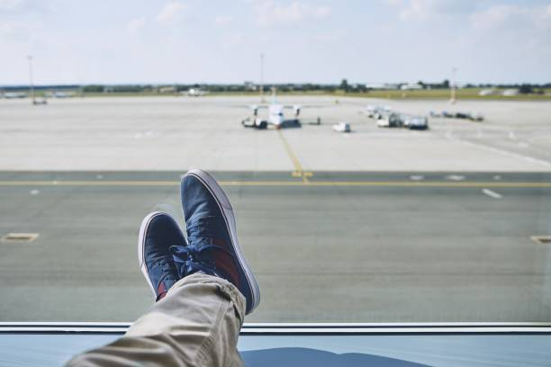 Man waiting at airport stock photo