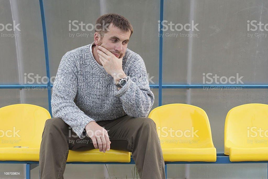 Man waiting at the bus stop royalty-free stock photo