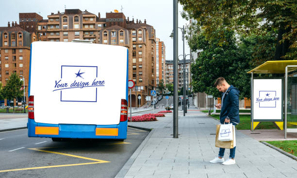 man waiting bus looking mobile. customizable bus, bag and canopy - tree logo stock photos and pictures