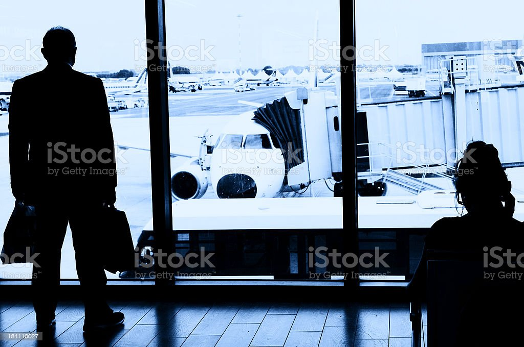 Man Waiting for Flight in Airport Lounge royalty-free stock photo