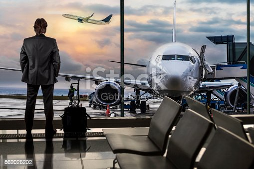 istock Man Waiting for Flight in Airport Lounge 862026202