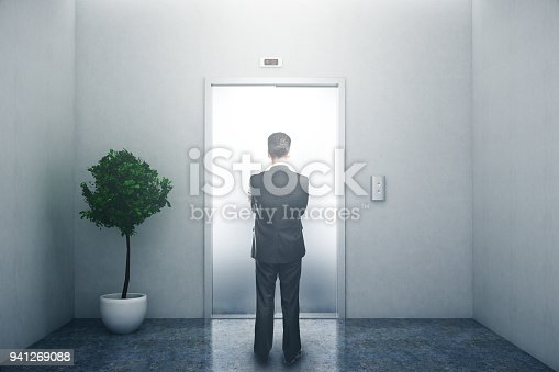 638591126 istock photo Man waiting for lift 941269088