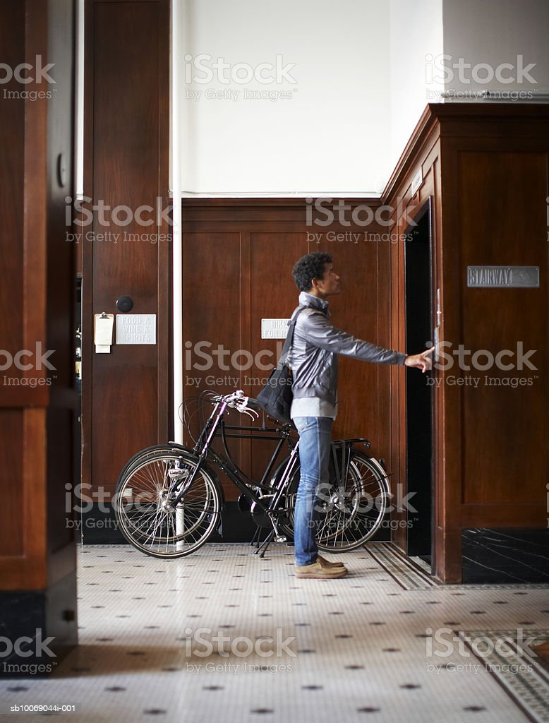 Man waiting for lift, side view royalty-free stock photo