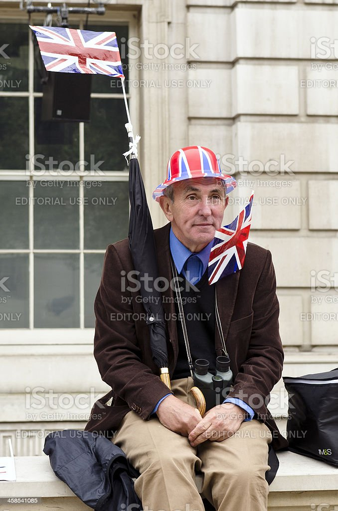 Man waiting for Royal Wedding, London stock photo
