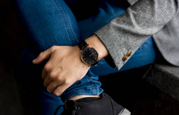 Man waiting for someone to come Man waiting for someone to come luxury watch stock pictures, royalty-free photos & images